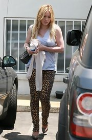 Hilary pulled off a funky pair of leopard-printed Beetle Juice pants with nude heels and a casual tank.