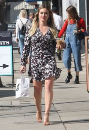 Hilary Duff teamed her cute dress with nude ankle-tie sandals by Aquazzura.