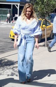 Hilary Duff completed her boho-inspired look with a pair of wide-leg jeans.