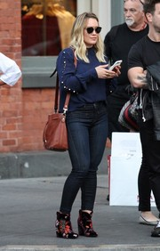 Hilary Duff kept it modest in a blue Intermix blouse with button-up sleeves while out and about in New York City.