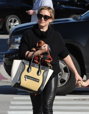 Hilary Duff carried a Céline purse while running errands in West Hollywood for a classic look.