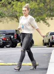 Hilary Duff stepped up the edginess with a pair of gray suede ankle boots.