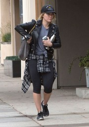 Hilary Duff headed to the gym wearing capri leggings and a leather moto jacket.