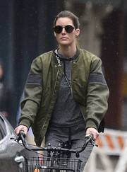 Hilary Rhoda put on a pair of round shades for a bike ride around Soho.
