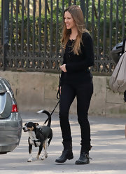 Hilary Swank walked her dog in a Parisian park while wearing a pair of casual black leather boots.