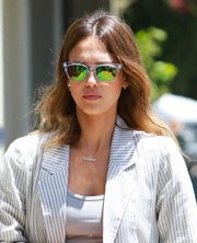 Jessica Alba rocked reflective wayfarers with green lenses for a trip to the nail salon.