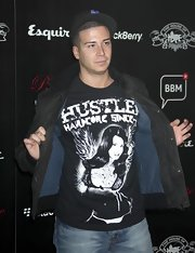 "Jersey Shore's Vinny sports a black and white statement tee emblazoned with a scantily clad angel to show what a ""Hustler"" he is."