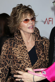 Jane Fonda hit the red carpet in a pair of orange rimless sunglasses.