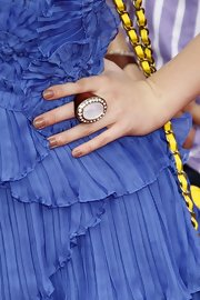 "Bella Thorne was all-too-cute in her ruffled violet dress at the ""How To Train A Dragon"" premiere. She added a gemstone cocktail ring to bring her look up a notch."