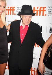 The original playboy hit a screening of his biopic in Toronto wearing a classic fedora.