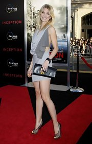 AnnaLynne paired her mesh peep toe heels with a leather Je Te Tiens clutch.