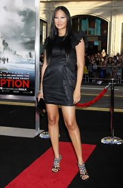 Kimora showed off her model gams while hitting the red carpet in a black satin cocktail dres.