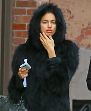 Irina's nail polish really popped against her black fur coat.