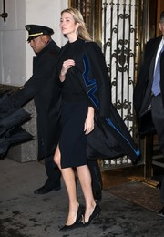 Ivanka Trump teamed her coat with a dark-blue pencil skirt and a black sweater.