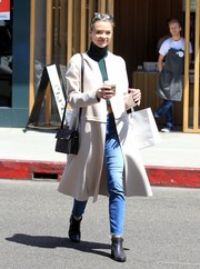 Jaime King teamed high-waisted jeans by Mother with a green turtleneck crop-top for a day of shopping.