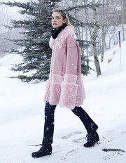 Jaime King geared up for Sundance weather with a pair of snow boots and a pink fleece coat.