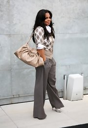 Janet went preppy at the Armani show in pinstriped trousers and these Alta Arielle a Talon python pumps.