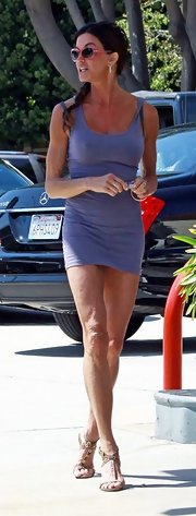 Janice dons a mini lilac dress with heels while stopping for gas in LA.