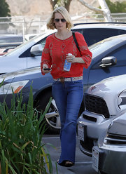 January Jones was a regular earth mom in flared jeans with a woven belt.