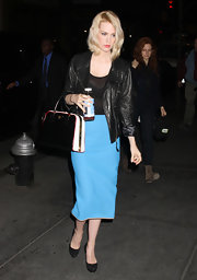 January Jones accented her vivid turquoise pencil skirt with a structured tri-color Prada tote.