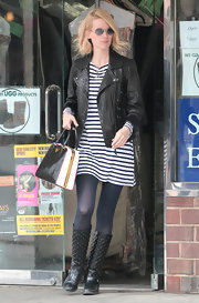 January Jones toughed her nautical striped dress with a black leather biker jacket.