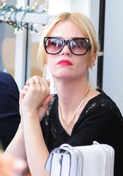 January Jones looked stylish wearing a pair of cateye sunnies by Bulgari while out in Beverly Hills.