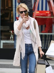 January Jones paired a patterned scarf with a cardigan for her cozy look.