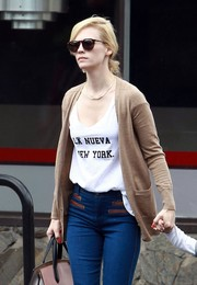 January Jones topped off her look with a pair of round shades.