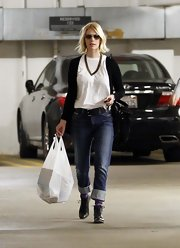 January Jones embraced a very different look from her 'Mad Men' persona in cuffed jeans and boots.