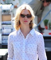 January Jones accessorized with a pair of tortoiseshell shades for a sunny day out.