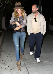 Rosie Huntington-Whiteley went for a grunge-chic date look with a pair of ripped skinny jeans.