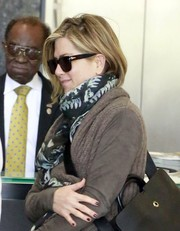 Jennifer Aniston teamed a printed scarf by Balmain with a shawl-collar cardigan for a visit to a Beverly Hills spa.