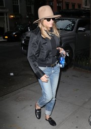 Jennifer Aniston stayed on trend in a black bomber jacket while out and about in New York City.