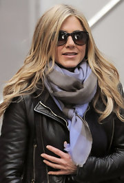 Jennifer Aniston looked fab in a pair of cat eye sunglasses. A pale blue scarf completes her casual chic look.
