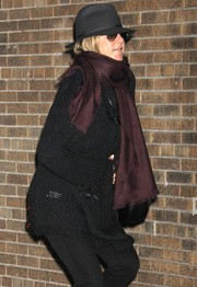 Jennifer Aniston accessorized with a burgundy silk scarf for a subtle splash of color to her black outfit.