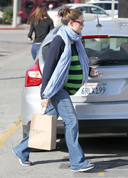 Jennifer Garner punched up her casual look with a navy and lime green striped sweater.