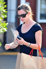 """Jennifer keeps her style simple and stylish. She is wearing the new """"6208/S"""" sunglass. They have a solid black lens with gold detail. This is a glam take on a basic sunglass style."""