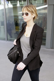 Jennifer Lawrence was no-nonsense wearing this black blazer out in London.