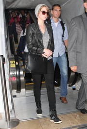 Jennifer Lawrence looked rugged in a black leather jacket layered over a gray V-neck tee as she arrived on a flight at LAX.