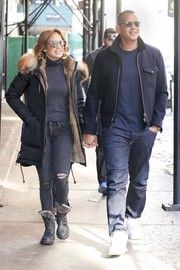 Jennifer Lopez teamed her luxurious coat with Rag & Bone ripped jeans and a turtleneck.