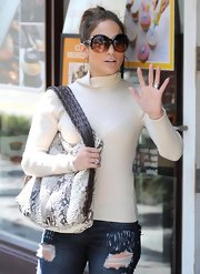 J-Lo sports a pair of round lens oversized sunglasses while shopping at The Grove.