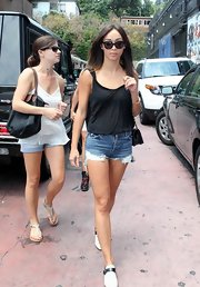 A pair of cutoff denim shorts kept Cara casual and cool in the summer sun.