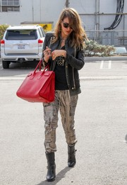 Jessica Alba sealed off her rocker-chic look with black moto boots by Jimmy Choo.