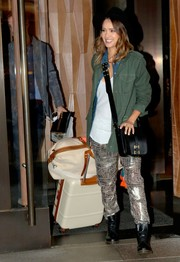 Jessica Alba teamed her jacket with shimmery print pants by Isabel Marant for H&M.