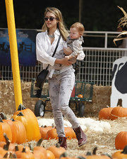 Jessica Alba looked cute and chic for a day of picking pumpkins in weather-appropriate floral denim.
