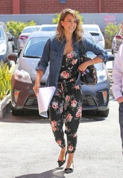 Jessica Alba toughened up her jumpsuit with a denim shirt.