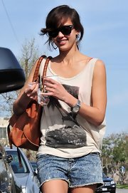 California-girl Jessica Alba paired this casual tank with jean shorts and wayfarer sunglasses.