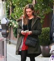 Jessica Alba was sporty-glam in a fur-lined army-green parka while shopping in Beverly Hills.