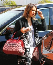 Jessica Alba showed off a personalized woven-leather tote by Fendi as she headed to her office.