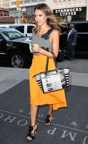 Jessica Alba styled her chic outfit with a black-and-white printed tote by Christian Louboutin.